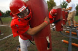 (DENVER, Co., SHOT 9/29/2004) Denver East High School LB Rashaad Marsh, a sophomore on the team,...
