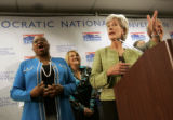 Kansas Gov. Kathleen Sebelius, right, a possible vice presidential candidate, makes a joke while...