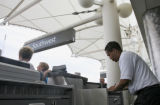 Southwest  Sky-Cap, Day Butler,(cq), checks in customers baggage, Thursday afternoon, June 23,...
