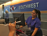 Southwest Lilian Media (cq), checks in customers, Thursday afternoon, June 23, 2008, DIA, Denver....