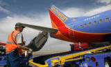 Southwest  ramp worker Jim Tuttle, loads a jet,Thursday afternoon, June 23, 2008, DIA, Denver....