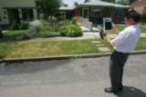 John Aguilar, of Denver Water, takes a picture of a sprinkler before issueing a warning for...