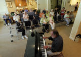DM0170  Piano player Cuck Smith entertains the residents at The Village at Saint Catherine's, a...
