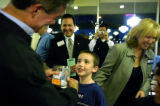 (Denver, Colo., October 14, 2004)Jack Kacik, 7, Denver, smiles as Governor Bill Owens compares his...