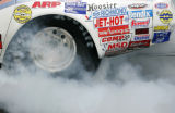 A car smokes it's ties in the Super Comp qualifier at the Mile-High Nationals at Bandimere...
