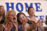 DeAnna Hornbacher, of Littleton, cheers during a welcome home presentation at hanger 909 at...