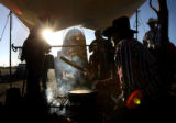 (PG1511) Tom Watson makes sausage gravy for the group before the cowboys head out for the Cheyenne...