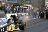 Tony Schumacher races in the semi-final round at the Mile-High Nationals at Bandimere Speedway in...