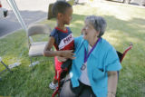 DM0286  Ellie Valdez-Honeyman visits with 7-year-old Jah-Sun Collier during a carnival/fundraiser...
