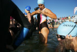 Carisa Verdoia (cq) (center) adjusts her swimsuit before beginning the swimming portion of the...