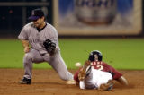 HTA102 - Colorado Rockies second baseman Aaron Miles, left, can't get a glove on the ball as...