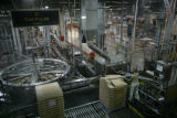 A Budweiser employee works inside the Anheiser Busch plant in Fort Collins, Colorado. July 14,...