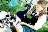Lena Gibbs, of Lakewood, gives her bagpipes a tune up in between performances with the Colorado...