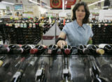 Suzanne Ray (cq) shops for red wine at Lukas Liquor Superstore in Lone Tree, Colo., on Monday,...