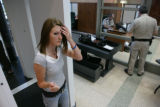 Heather Stone, 20, (cq) walks through the Douglas County Justice's new security system.  The L3...