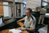 Mike Couts (cq) a custom protection officer at Douglas County Justice tells an individual they can...