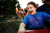(PG05600) Nicolas Gonzales, 8, and his dad, Tim Sartin, ride the Dragon roller coaster at Lakeside...