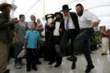 (PG02856) Orthodox Jews celebrate the arrival of the Torah Scroll at Denver International Airport...