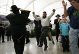 (PG02830) Orthodox Jews celebrate the arrival of the Torah Scroll at Denver International Airport...
