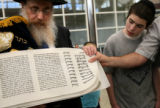 (PG03225) Rabbi Yisroel Engel shows the Scroll of Esther to illustrate to reporters what the Torah...