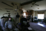 George Barrie (cq) sits in the middle of his living-room at his home in Craig, Colorado. He worked...