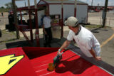 Jeff Case (cq) fills his grand american modified race car with race fuel at Colorado National...