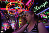 MJM1501 Rhonda Cox, center, of the United Kingdom, plays a slot machine next to her friend,...