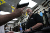 MJM1959 A customer handles a hand gun as owner of The Gun Trader, Frank Morreale (cq), right,...