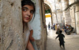 NYT12 - (NYT12) JERUSALEM -- October 15, 2004 -- MIDEAST-2 -- A Palestinian girl looks out from...