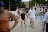 Melissa Stockwell (cq) walks along a pool deck talking with one of her coaches, Jimi Flowers (cq)....