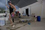 "Melissa Stockwell (cq), puts her artificial leg on after a swim meet. ""It is a motivation and..."