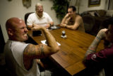 Steven Husong, 43, a former army sergeant (cq) flexes his muscles to humor Dave Roever (cq) (white...