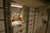 CODER109 - Qwest technicians work inside the Democratic National Convention Committee server room...