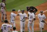 Chris Iannetta (cq) of the Colorado Rockies  high-fives teammates after cranking a home run versus...