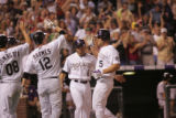 Coming into home plate after hitting a grand slam in the seventh inning Matt Holliday (cq), gives...