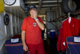 Darrell Smith (cq), a superstock driver wipes sweat off his face after completing his practice...