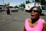 Detra Pugh, 49, cries in the parking lot outside the Salvation Army during a picnic for the...