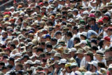 Spectators watch a race at the Mile-High Nationals at Bandimere Speedway in Morrison on Sunday,...