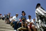 Spectators brace during a race at the Mile-High Nationals at Bandimere Speedway in Morrison on...