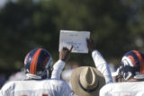 Defensive line coach Jacob Burney (cq) points out a play to #94-Jarvis Moss (cq)  (left) and...