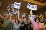 Mark Udall supporters hold signs at the first debate against opponent Bob Schaffer at Wildlife...