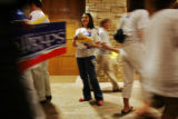 Katie Granger hands out fliers to Bob Schaffer supporters after the first debate against his...