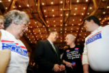 Bob Schaffer talks with supporters after the first debate against his opponent Mark Udall in the...