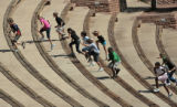 A group of children from the YMCA of Metropolitan Denver run up some of the new seats at Red...