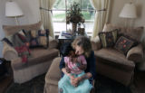 Kari Grossman holds her child Shanti Grossman, 4, at their parents home in Denver, Colo., on...