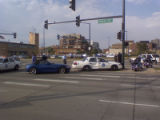 A Denver police car responding to a robbery call with lights and siren is struck by a BMW Z4 at...