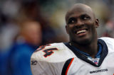 (OAKLAND, CA., OCTOBER 17, 2004)  Denver Broncos' #34, Reuben Droughns smiles back towards the...