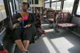 DM0050  Tamara Blanton, 25, rides a bus on RTD's route 727 on her way home from work in Greenwood...
