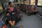 DM0053  Tamara Blanton, 25, rides a bus on RTD's route 727 on her way home from work in Greenwood...
