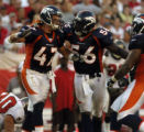 (Tampa, Fla., on Sun. Oct. 3, 2004)   Denver Broncos safety John Lynch, #47, celebrates  with...